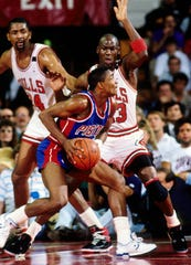 Pistons guard Isiah Thomas drives to the basket defended by Bulls guard Michael Jordan during the 1989 Eastern Conference finals at Chicago Stadium.