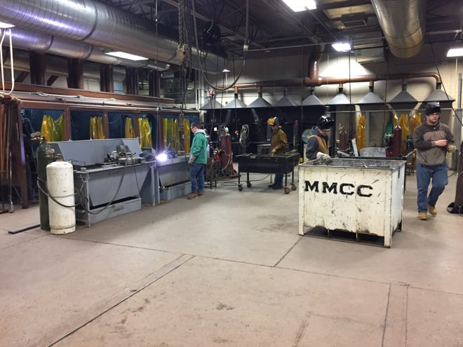 Students work in a welding class in January at Mid-Michigan Community College.