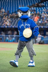 Ace, the Toronto Blue Jays mascot, walks across the the field before the start of the game against the Baltimore Orioles at Rogers Centre.
