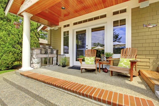 Budget-friendly upgrades such as fresh paint, area rugs and comfortable furniture can revitalize your porch. (Dreamstime/TNS)