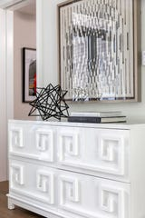 A lacquered dresser adds an instant sense of elegance.