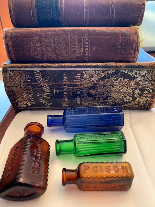 "The bottle collection (only some are pictured) includes poison bottles, herbal ""cures"" and medications that contain what we now know are poisons."