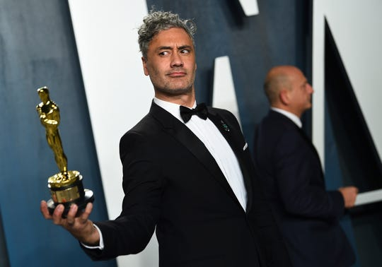 "Taika Waititi, winner of the award for best adapted screenplay for ""Jojo Rabbit,"" arrives at the Vanity Fair Oscar Party on Sunday, Feb. 9, 2020, in Beverly Hills, Calif."