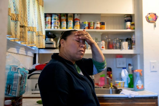 """After cooking their one meal for the day of beans, egg, and handmade tortillas, Janeth worries while standing in her kitchen, Wednesday, April 15, 2020, in Washington. """"Where can we get enough food? How can we pay our bills? We have never had to ask for help before,"""" says Janeth, with tears winding their way down her cheeks."""
