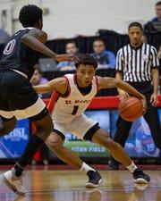 Orchard Lake St. Mary's Julian Roper Jr. says he'll play basketball at Northwestern.