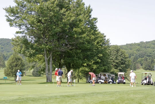 Golfers practice at Mark Twain Golf Course in 2014.