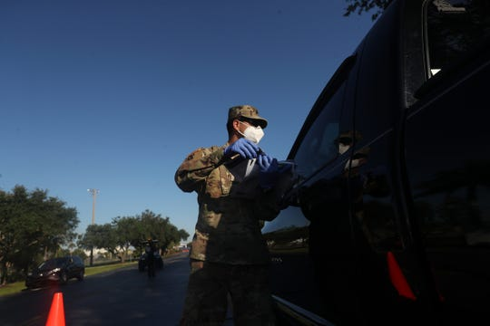 Vehicles line up at Century Link Sports Complex in Fort Myers on Monday, May 4, 2020. A drive in testing site has been set up by the National Guard. collections will start at 9 a.m. and last until 5 p.m for an indefinite period.