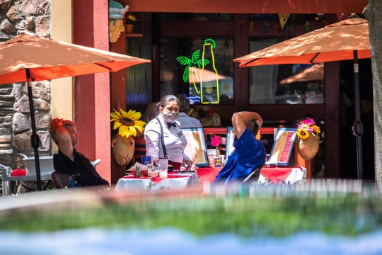 Diners eat outside at Cantinflas on Main Street in Greenville, Monday, May 4, 2020, the first day that restaurants downtown began to reopen outdoor seating since Governor Henry McMaster banned on-premises dining on March 18.