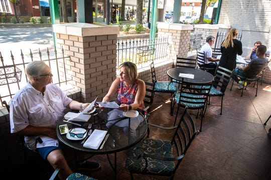 Vickie and Jeff Ford, of Greenville, celebrate Jeff Ford's 65th birthday at Pomegranate on Main Monday, May 4, 2020, the first day that restaurants downtown began to reopen outdoor seating since Governor Henry McMaster banned on-premises dining on March 18.