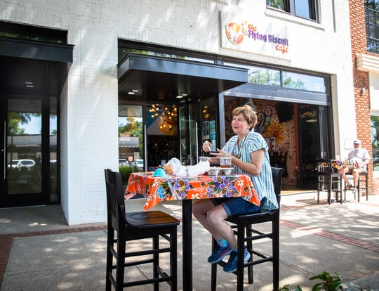 Kathy McLendon has lunch outside at Flying Biscuit Cafe on Main Street in Greenville, Monday, May 4, 2020, the first day that restaurants downtown began to reopen outdoor seating since Governor Henry McMaster banned on-premises dining on March 18.
