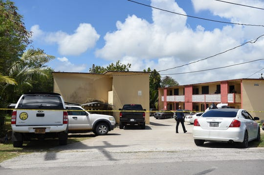 Guam Police Department officers conduct a death investigation at the Taitano Rentals apartment complex on JA Camacho Street in Mongmong, May 4, 2020.