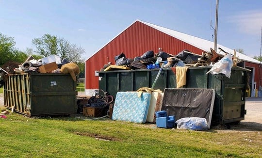 County officials said people kept bringing items to the bulk waste drop off site at Cairo Volunteer Fire Department long after the dumpsters were full. This picture was taken after cleanup around the dumpsters began (May 2020).