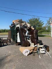 Trash overflows a dumpsters at one of three drop off sites in the county. The drop off sites were arranged for Spring Clean Up Day (May 2, 2020).