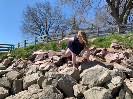 """University of Iowa senior dance student Emily Buttolph performing """"A Redirect Again,"""" for the May 7, 2020, virtual BFA Dance Concert."""