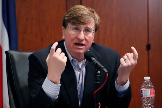 Republican Gov. Tate Reeves questions if lawmakers followed the state constitution and their own rules when they passed a bill May 1, that takes control of the federal CARES Act money, during his daily update on the state's response to COVID-19, Monday, May 4, 2020, in Jackson, Miss. (AP Photo/Rogelio V. Solis)