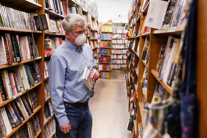 Mark Haugan of West Lafayette looks through the book shelves inside Von's Shops, Monday, May 4, 2020 in West Lafayette.