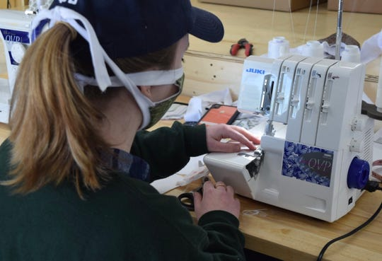 An employee at Carriage House Printery works on a coronavirus face mask Monday. The Carroll-based company is making 1,500 masks for Fairfield County government employees.
