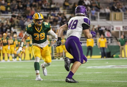 Brighton's Isaac Darkangelo (38) has transferred to Illinois after two seasons on Northern Michigan's football team.