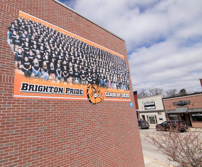 The Pound in downtown Brighton, shown Monday, May 4, 2020, displays a banner promoting the Brighton High School class of 2020 on the side of the bar.
