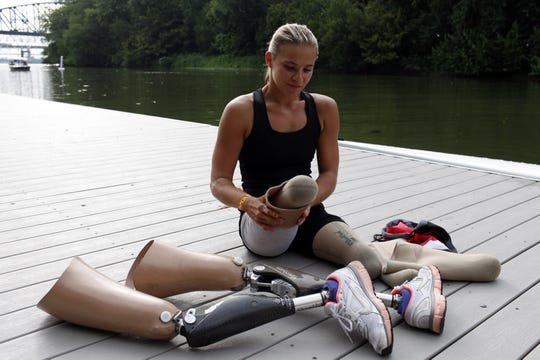 Oksana Masters prepares to row with partner Rob Jones on the Ohio River. Masters and Jones are preparing for the Paralympics in London, which will be held Aug. 31-Sept. 2. They currently hold the third fastest rowing time in the world and are hoping to finish strong in the mix double skull competition.  July 14, 2012