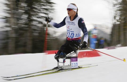 Oksana Masters of United States races to win silver medal in the ladies 12km cross country ski, sitting event at the 2014 Winter Paralympic, Sunday, March 9, 2014, in Krasnaya Polyana, Russia. (AP Photo/Dmitry Lovetsky)