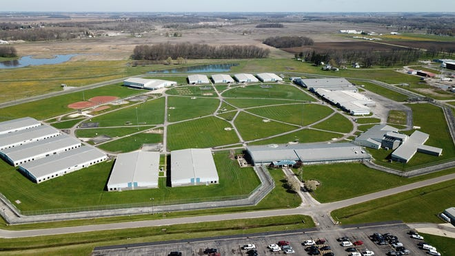 "A North Central Correctional Complex employee says the privately-operated prison is a ""powder keg,"" with tensions running high as the novel coronavirus continues its sweep through the prison."