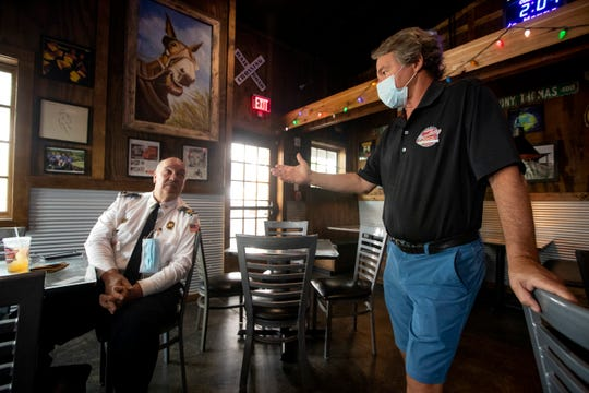 Collierville Commissary owner Walker Taylor chats with Fire Chief Buddy Billings, one of his first customers as the restaurant reopens for dine-in service on Monday, May 4, 2020. Monday marked the first day of Shelby County's 'Phase 1' plan to slowly lift restrictions on public gathering, including allowing restaurants to hold 50 percent of their capacity for dining room service.