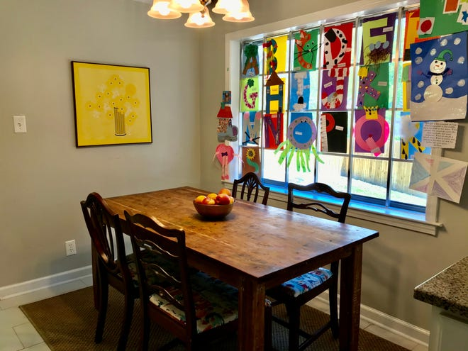 This kid-friendly space is filled with the children's colorful artwork.