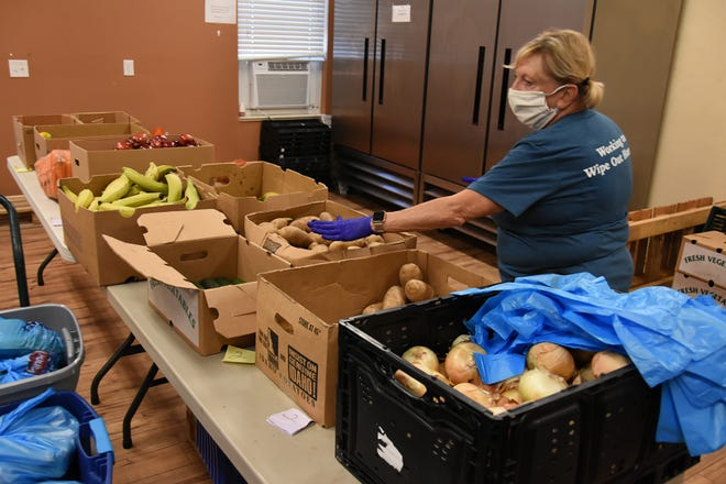 Volunteer Kathy Swaja fills bags of fresh produce. Our Daily Bread food pantry fed 622 families on Marco Island last week, providing each with at least 45-50 lbs. of a variety of grocery items.