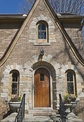 For a Tudor home, two large, decorative planters go well with the architecture. These are at the Wauwatosa home of Kristyn Greenfield.
