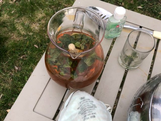 Mint Juleps were poured from a pitcher into plastic cups that could be disposed of after use.
