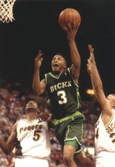 Second-year guard Eric Murdock drives the Bucks to victory with 20 points and 11 assists in a game against the Pacers in 1993.