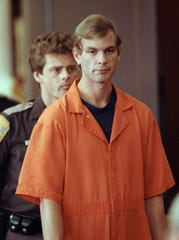 """Jeffrey L. Dahmer enters a Milwaukee courtroom on Aug. 6, 1991. Dahmer, who murdered 17 men and boys over a 13-year period, is the focus of a new Investigation Discovery program, """"Jeffrey Dahmer: Mind of a Monster."""""""