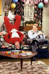"""Robin Williams is Mork and Ron Howard take a break in the episode of """"Happy Days"""" that debuted the iconic Williams character. """"Mork & Mindy,"""" which spun off from the episode, was one of the creations of prolific producer Garry Marshall, who is celebrated in the new special """"The Happy Days of Garry Marshall,"""" airing at 7 p.m. May 12 on ABC."""
