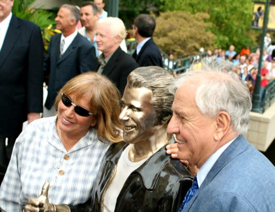 """""""Happy Days"""" and """"Laverne and Shirley"""" producer Garry Marshall, right, poses with his sister, Penny Marshall, and the Bronze Fonz in Milwaukee in 2008. Garry Marshall is the focus of """"The Happy Days of Garry Marshall,"""" premiering on ABC May 12, 2020."""