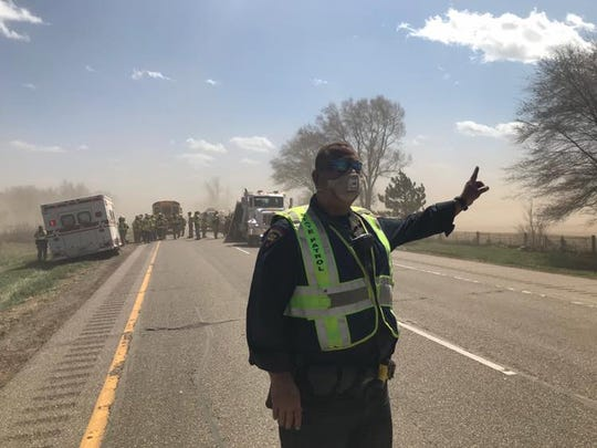 Blowing dust from farm fields caused a chain-reaction crash involving an estimated 26 vehicles on I-39 near Plainfield Sunday.