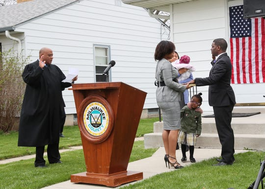 Appeals Court Judge Joe Donald swore in new County Executive David Crowley in front of Crowley's home in Milwaukee. Surrounded by family, friends and neighbors, he took the oath of office in his front yard and then addressed those assembled.