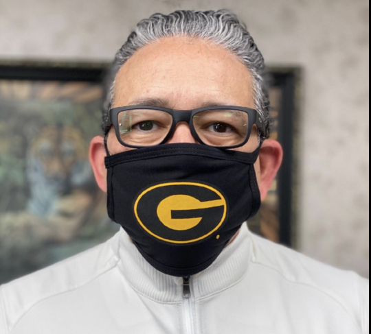 Grambling State University President Rick Gallot wears an officially licensed mask with the GSU logo.