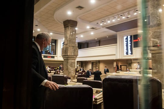 Representatives find their seats as the Alabama House of Representatives at the State House in Montgomery, Ala., on Monday, May 4, 2020.