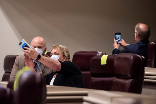 Representatives take selfies as the Alabama House of Representatives restarts the session at the State House in Montgomery, Ala., on Monday, May 4, 2020.