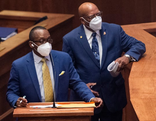 State Sen. Bobby Singleton and Rodger Smitherman talk as the Alabama Senate restarts the session at the State House in Montgomery, Ala., on Monday, May 4, 2020.