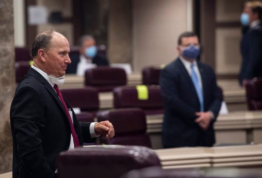 State Rep. Reed Ingram enters the floor as the Alabama House of Representatives restarts the session at the State House in Montgomery, Ala., on Monday, May 4, 2020.