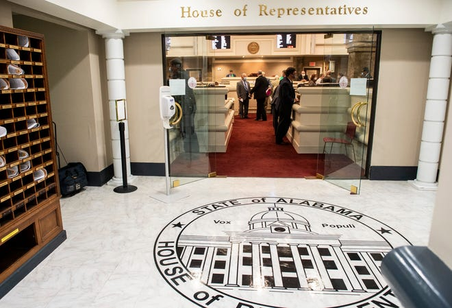 Representatives talk after a recess as the Alabama House of Representatives restarts the session at the State House in Montgomery, Ala., on Monday, May 4, 2020.