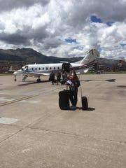 Gracie Dale in Cusco, Peru, getting ready to fly inside a  U.S. Military plane to Lima, Peru.