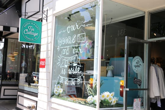 Tin Cottage greeted customers with its window display on May 4, 2020.
