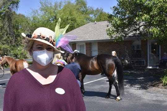 "Krisha Owens gets into the Kentucky Derby spirit for ""Distance Derbying"" at Red Cedar Glen senior living community in Hendersonville on Friday, May 1."