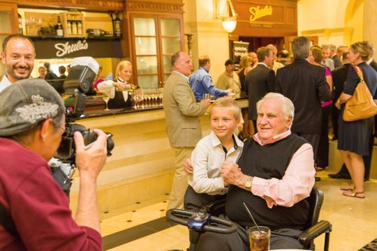 On March 20, 2013, Pro Football Hall of Famer Don Shula poses for a photo with 8-year-old Nick Ellington, of Bonita Springs, at a dinner to feature Football Hall of Famer Mike Ditka's new wines at Shula's Steak House at the Hilton Naples in Naples. The former Dolphins coach died on Monday, May 4, 2020.