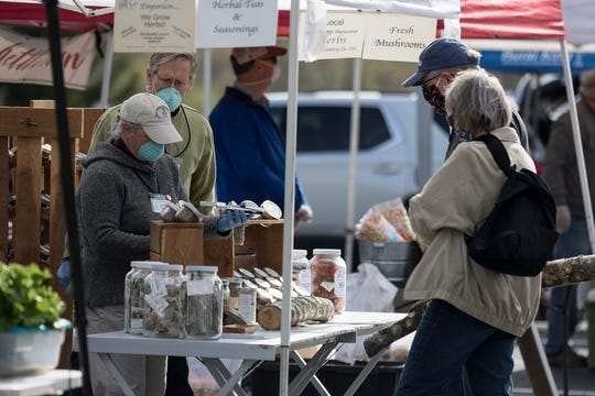 Shoppers and vendors wore masks masks at the Granville Farmers Market Saturday, now located at Granville High School. The new location allows for more space for shoppers and vendors to spread out to follow social distancing guidelines.