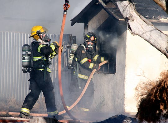 Deming firefighters worked feverishly to battle hot spots at the 700 block of E. Poplar St.