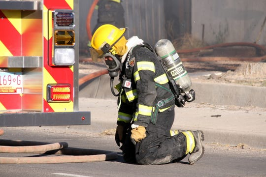 Deming firefighters battled high temperatures and thick smoke during Sunday's structural fire.